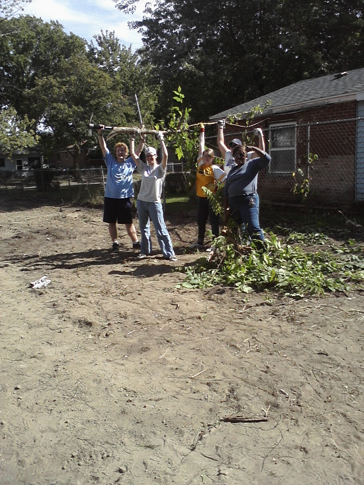 Students helping a local community clean-up project